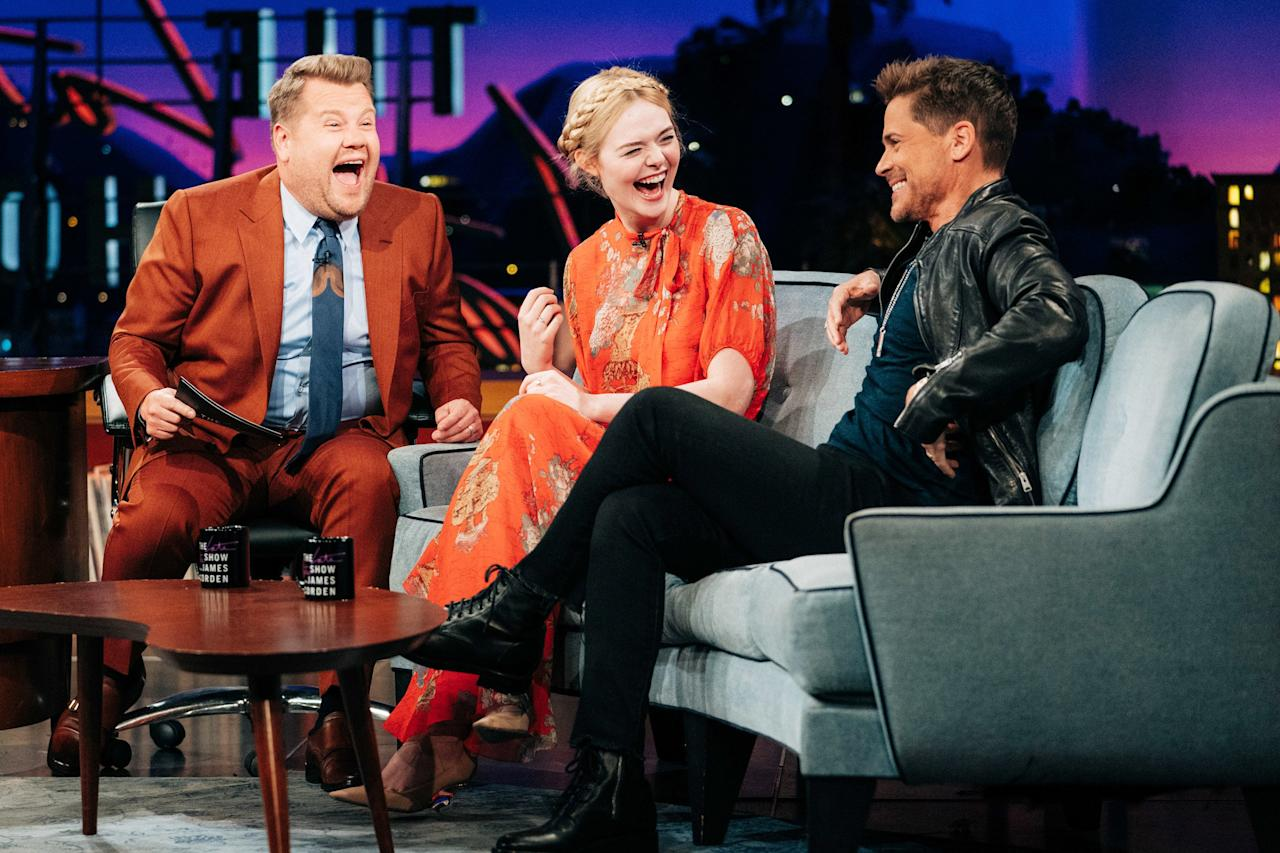 Host James Corden cracks up alongside guests Elle Fanning and Rob Lowe on Tuesday's episode of <i>The Late Late Show</i> in L.A.