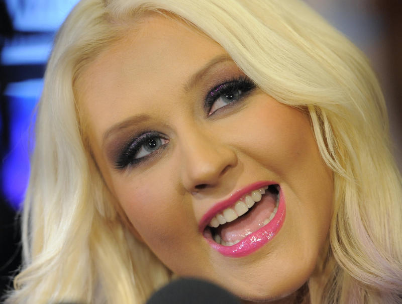 Singer Christina Aguilera is interviewed after announcing nominations for the 2012 American Music Awards at the J.W. Marriott L.A. Live on Tuesday, Oct. 9, 2012, in Los Angeles. The 40th Anniversary American Music Awards will be held on November 18 at the Nokia Theatre in Los Angeles. (Photo by Chris Pizzello/Invision/AP)