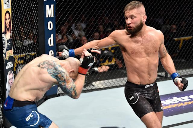Josh Emmett (L) battles Jeremy Stephens Saturday in a bout Stephens won by second-round finish at the Amway Center in Orlando, Fla. (Getty Images)