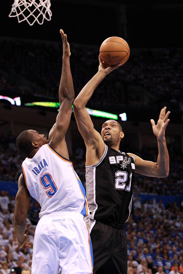 OKLAHOMA CITY, OK - JUNE 02:  Tim Duncan #21 of the San Antonio Spurs shoots over Serge Ibaka #9 of the Oklahoma City Thunder in the first half in Game Four of the Western Conference Finals of the 2012 NBA Playoffs at Chesapeake Energy Arena on June 2, 2012 in Oklahoma City, Oklahoma. NOTE TO USER: User expressly acknowledges and agrees that, by downloading and or using this photograph, User is consenting to the terms and conditions of the Getty Images License Agreement.  (Photo by Ronald Martinez/Getty Images)