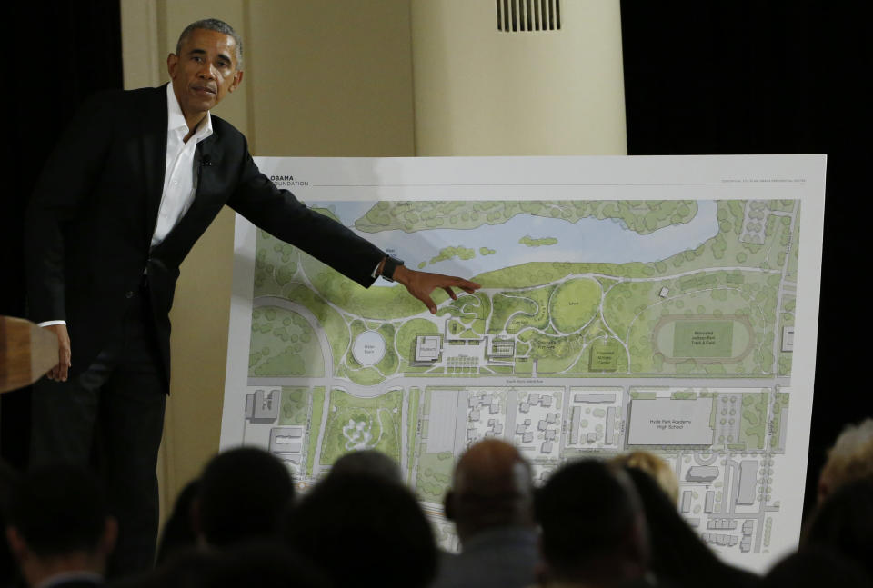 FILE - In this May 3, 2017, file photo, former President Barack Obama points to a rendering for the former president's lakefront presidential center at a community event at the South Shore Cultural Center in Chicago. Obama's presidential center will move another step closer to its brick-and-mortar future Tuesday, Sept. 28, 2021 when ground is broken. (AP Photo/Nam Y. Huh, File)
