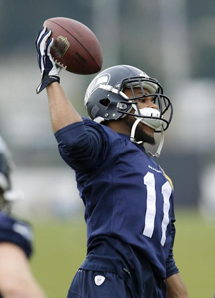 Seattle Seahawks NFL football wide receiver Percy Harvin catches a ball tossed to him during stretching warmups, Thursday, Jan. 2, 2014, before practice in Renton, Wash. (AP Photo/Ted S. Warren)