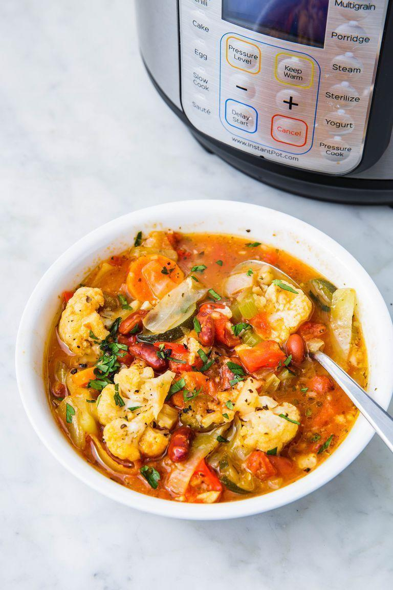 """<p>Loaded with cabbage, cauliflower, bell pepper, and courgette, this vegetable soup is a healthy way to warm up this winter.</p><p>Get the <a href=""""https://www.delish.com/uk/cooking/recipes/a30542736/instant-pot-vegetable-soup/"""" rel=""""nofollow noopener"""" target=""""_blank"""" data-ylk=""""slk:Instant Pot Vegetable Soup"""" class=""""link rapid-noclick-resp"""">Instant Pot Vegetable Soup</a> recipe.</p>"""