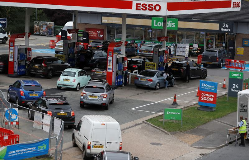 Drivers queue to enter a fuel station in London