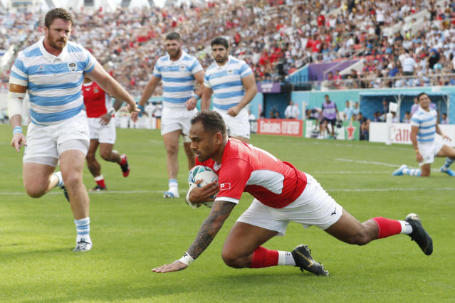 Tonga's Telusa Veainu scores a try during the Rugby World Cup Pool C game at Hanazono Rugby Stadium between Tonga and Argentina in Osaka, Japan, Saturday, Sept. 28, 2019. (Kyodo News via AP)