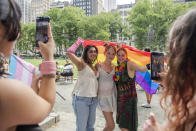 From left, Moneesha Syed, Evangeline Feeney and Lyla Gatterdam pose for photos at Bryant Park for the Queer Liberation March on Sunday, June 27, 2021, in New York. (AP Photo/Brittainy Newman)