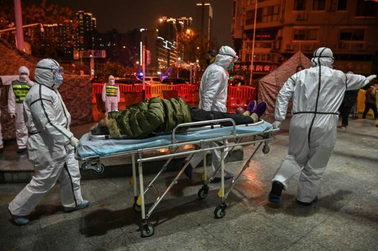Medical staff arrive with a patient at the Wuhan Red Cross Hospital, in an image captured by Hector Retamal