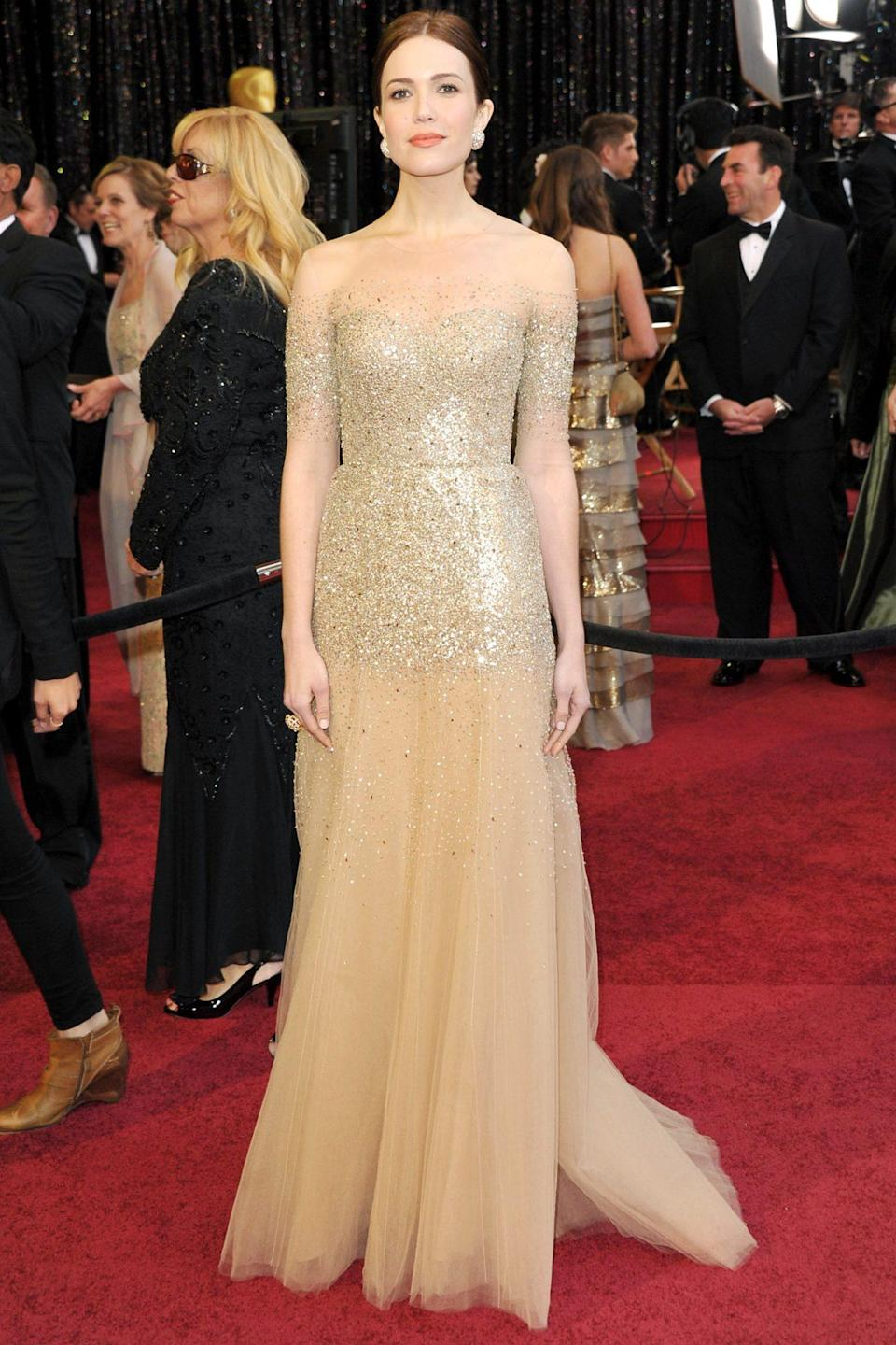 <p>All that glitters is...Mandy Moore's golden gown! The star sparkled on the red carpet in a Monique Lhuillier look fit for a princess. And good thing, because she was there to perform a song from the Disney movie <em>Tangled</em>, which was nominated for Best Original Song.</p>