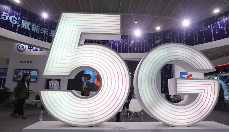 KUNMING, CHINA - MAY 23: An illuminated 5G sign is seen during the Tencent Global Digital Ecosystem Summit at Dianchi International Convention and Exhibition Center on May 23, 2019 in Kunming, Yunnan Province of China. The Tencent Global Digital Ecosystem Summit is held on May 21-23 in Kunming. (Photo by VCG/VCG via Getty Images)
