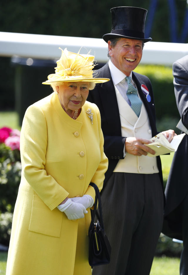 Britain Horse Racing - Royal Ascot - Ascot Racecourse - June 21, 2017 Britain's Queen Elizabeth II with Bloodstock and Racing Advisor John Warren before the 2.30 Jersey Stakes REUTERS/Eddie Keogh Livepic