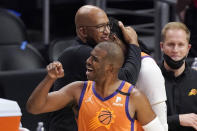 Phoenix Suns head coach Monty Williams, left, hugs Jae Crowder, second from right, while guard Chris Paul celebrates as time runs out in Game 6 of the NBA basketball Western Conference Finals against the Los Angeles Clippers Wednesday, June 30, 2021, in Los Angeles. The Suns won the game 130-103 to take the series 4-2. (AP Photo/Mark J. Terrill)