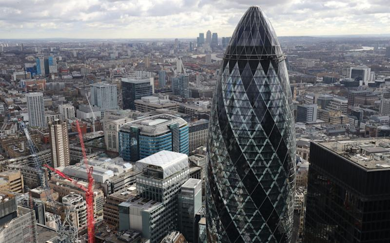 London skyline as seen from Tower 42 with the 'Gherkin' (foreground), 30 St Mary Axe and Canary Wharf (background) prominent.