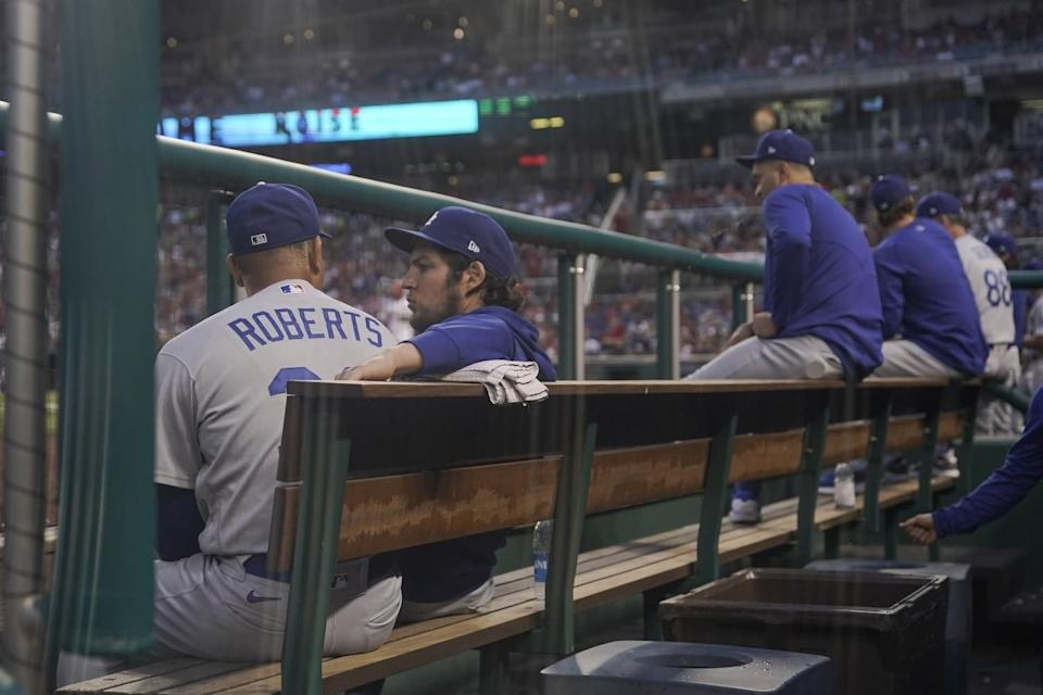 Dodgers pitcher Trevor Bauer sits with manager Dave Roberts during a game in Washington on July 1.