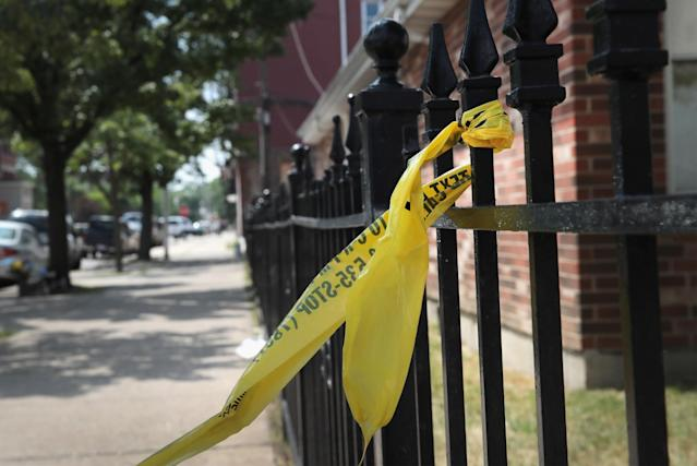 Crime-scene tape on a fence near the church where Salvador Suarez was gunned down in June 2016. (Photo: Scott Olson/Getty Images)