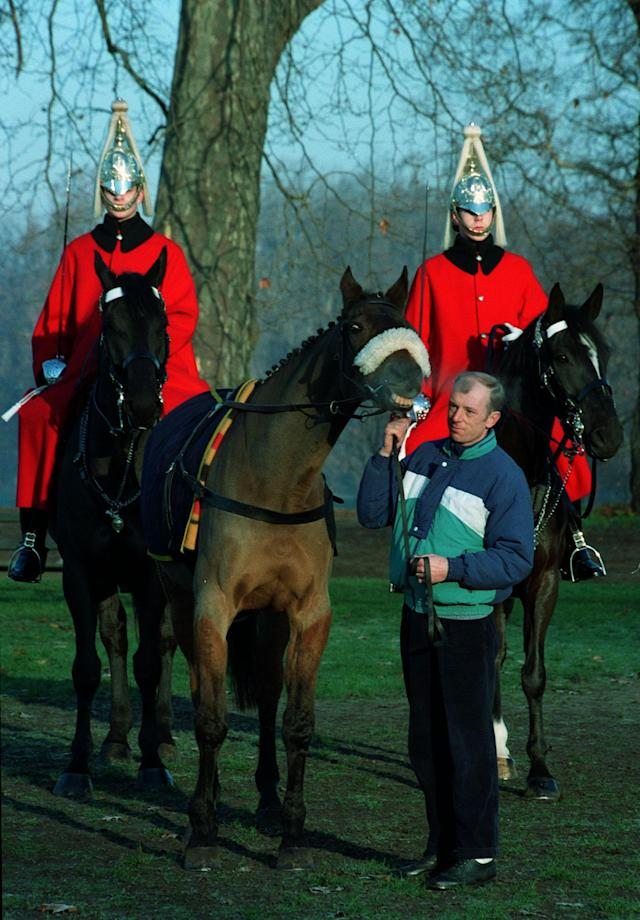 <p>Triple Grand National winner Red Rum with groom Ken Critchley. Rum won a record-breaking three titles. </p>