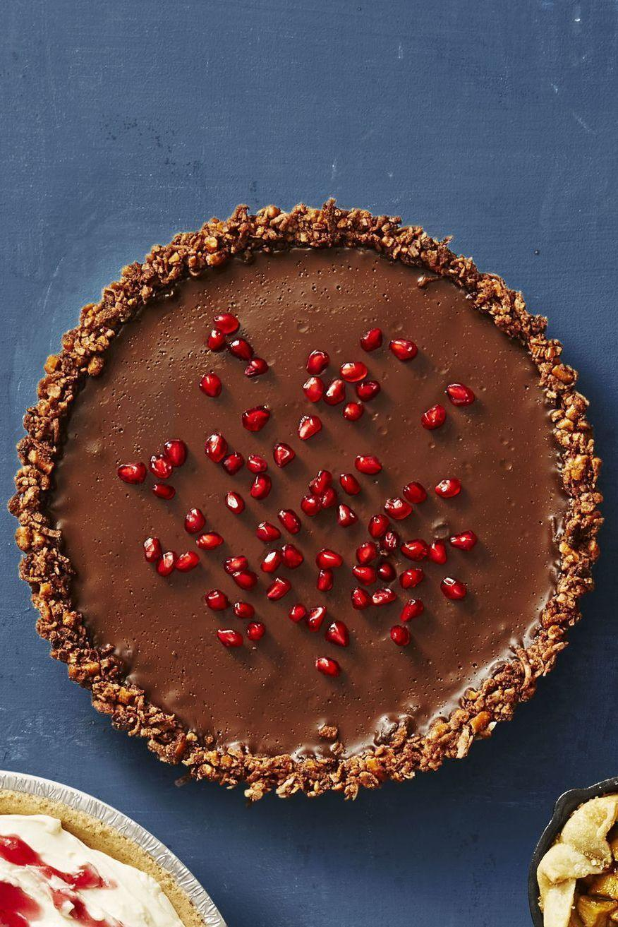 "<p>Once cool, sprinkle pomegranate seeds or berries on top of the tart to balance out the rich chocolate center. </p><p><em><a href=""https://www.goodhousekeeping.com/food-recipes/a41082/gluten-free-chocolate-ganache-tart-recipe/"" rel=""nofollow noopener"" target=""_blank"" data-ylk=""slk:Get the recipe for Gluten-Free Chocolate Ganache Tart »"" class=""link rapid-noclick-resp"">Get the recipe for Gluten-Free Chocolate Ganache Tart »</a></em></p>"