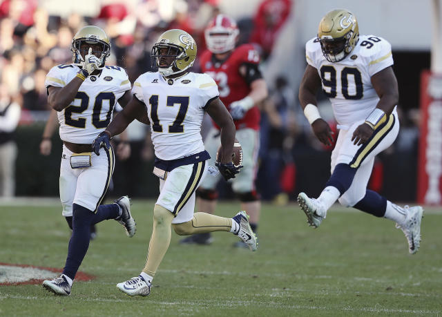 FILE - In this Nov. 26, 2016, file photo, Georgia Tech defensive back Lance Austin (17), Lawrence Austin (20) and Brandon Adams (90) celebrate after Austin intercepted a Georgia pass during an NCAA college football game in Athens, Ga. Adams has died at the age of 21. The school announced player's death Sunday, March 24, 2019. No cause was given. (Curtis Compton/Atlanta Journal-Constitution via AP, File)