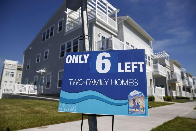 An advertisement for two-family homes is seen outside an oceanside community in the Rockaway area of the Queens borough of New York