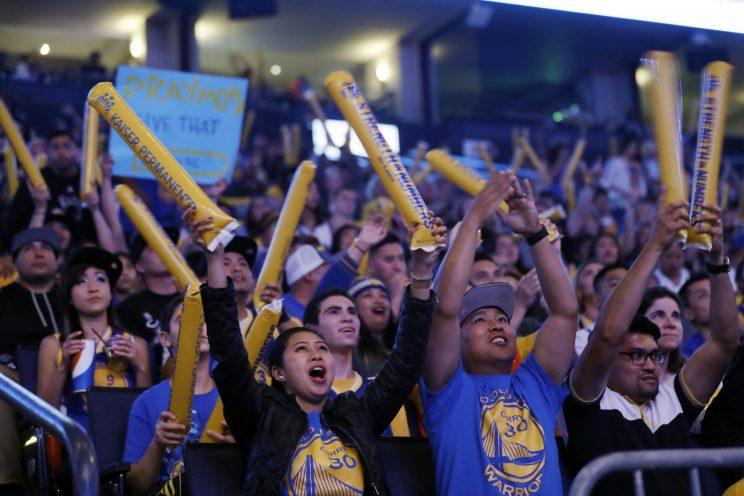 Warriors fans showed up en masse to watch Game 4 in Cleveland on the big screen at Oracle Arena. (AP)