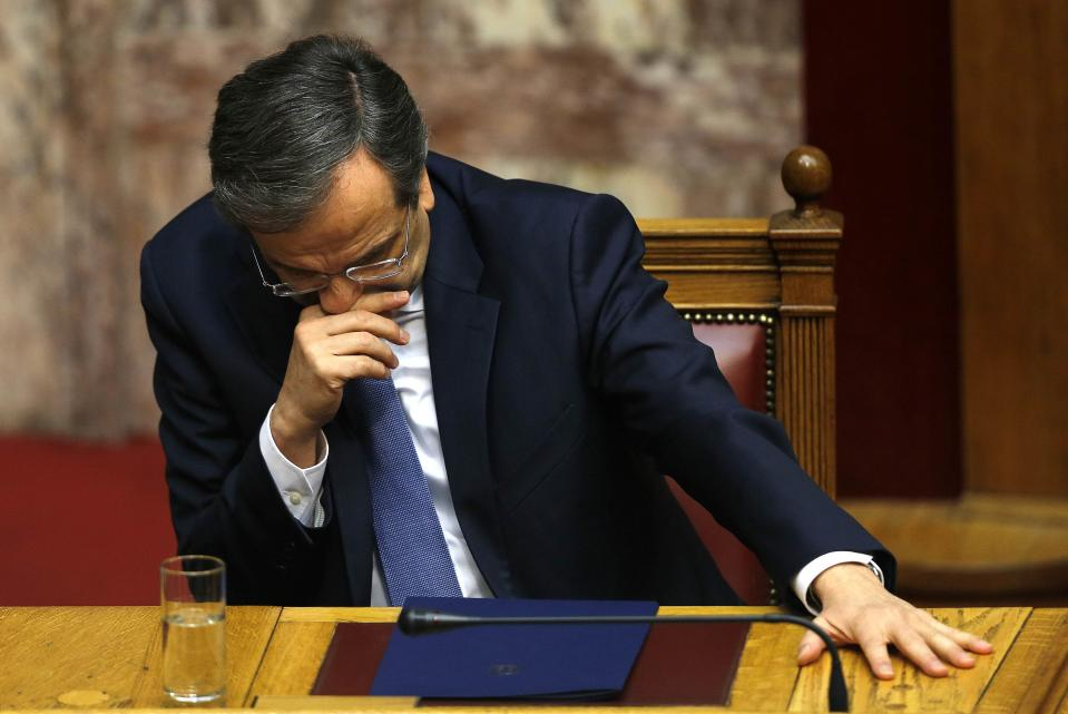 Greek Prime Minister Antonis Samaras reacts in parliament during the last round of a presidential vote in Athens December 29, 2014. Greek Prime Minister Samaras said he would propose holding an early national election on Jan. 25 after parliament rejected his nominee for president. REUTERS/Yannis Behrakis (GREECE - Tags: POLITICS ELECTIONS TPX IMAGES OF THE DAY)