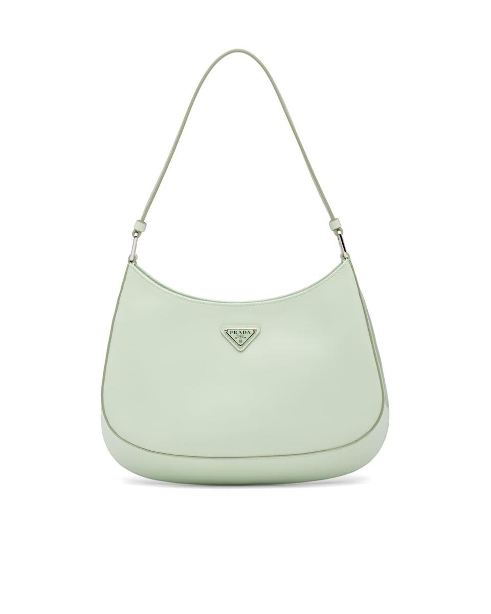 """<p><strong>Prada</strong></p><p>prada.com</p><p><strong>$1990.00</strong></p><p><a href=""""https://bs.serving-sys.com/Serving/adServer.bs?cn=trd&pli=1075981312&gdpr=%24%7BGDPR%7D&gdpr_consent=%24%7BGDPR_CONSENT_68%7D&adid=1081866557&pcp=%24%24%EF%BF%BDid%21%24%24&ord=%25%EF%BF%BDCHEBUSTER%25%25"""" rel=""""nofollow noopener"""" target=""""_blank"""" data-ylk=""""slk:Shop Now"""" class=""""link rapid-noclick-resp"""">Shop Now</a></p><p>We're already predicting this to be the It bag of the year. Already loved by influencer and celebrities, it's the bag you'll want to be the first of your friends to own.</p>"""