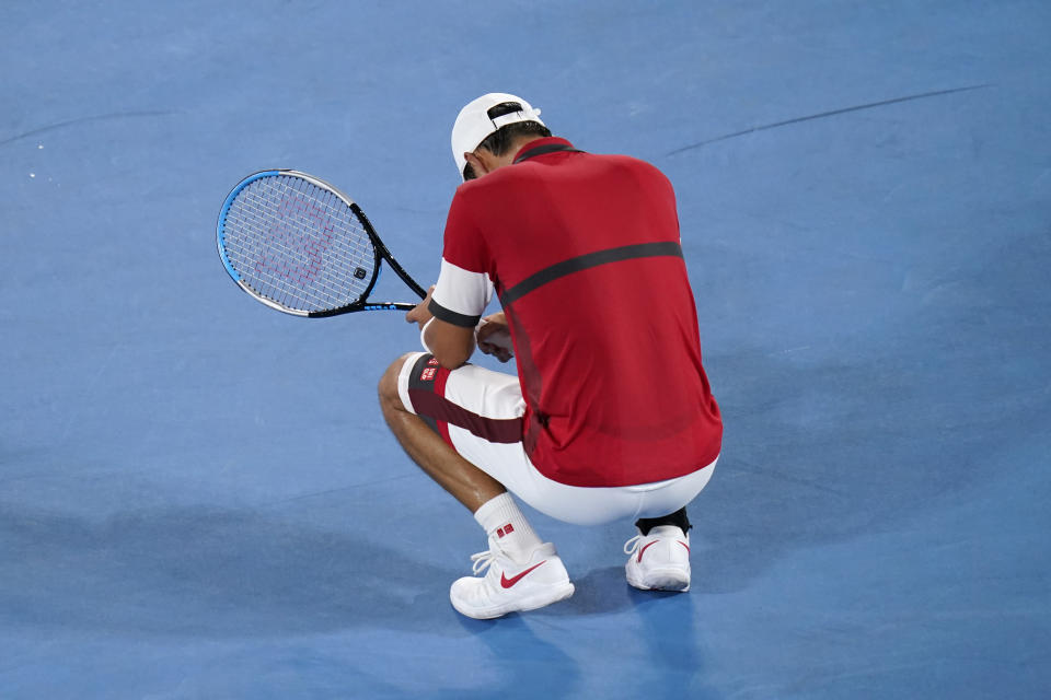 Kei Nishikori, of Japan, rests between points while playing Novak Djokovic, of Serbia, during the quarterfinals of the tennis competition at the 2020 Summer Olympics, Thursday, July 29, 2021, in Tokyo, Japan. (AP Photo/Seth Wenig)