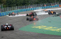 Cars drive out of the track after colliding during the Hungarian Formula One Grand Prix at the Hungaroring racetrack in Mogyorod, Hungary, Sunday, Aug. 1, 2021. (AP Photo/Darko Bandic)
