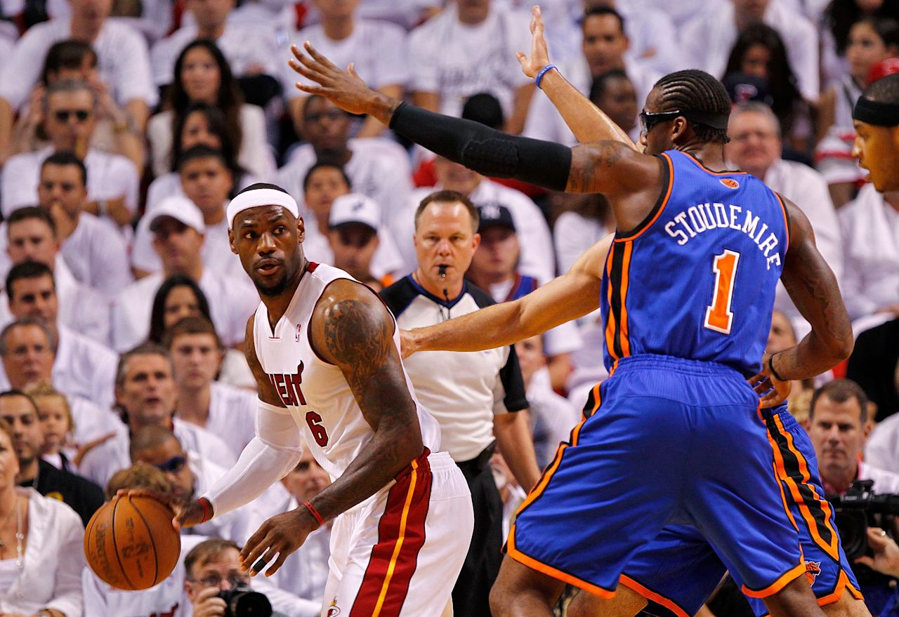 MIAMI, FL - APRIL 30:  LeBron James #6 of the Miami Heat posts up Amare Stoudemire #1 of the New York Knicks during Game Two of the Eastern Conference Quarterfinals in the 2012 NBA Playoffs  at American Airlines Arena on April 30, 2012 in Miami, Florida. NOTE TO USER: User expressly acknowledges and agrees that, by downloading and/or using this Photograph, User is consenting to the terms and conditions of the Getty Images License Agreement.  (Photo by Mike Ehrmann/Getty Images)