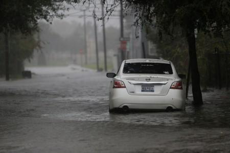 A car is surrounded by flood waters on Aiken Street during Hurricane Dorian in Charleston