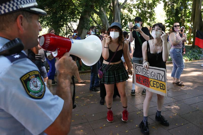 Protesters and police clash during a march on Australia Day in Sydney