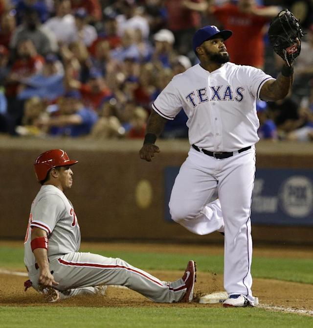 Texas Rangers first baseman Prince Fielder looks up at the ball in his glove after doubling off Philadelphia Phillies' Carlos Ruiz at first for a double play in the fifth inning of a baseball game, Tuesday, April 1, 2014, in Arlington, Texas. Ruiz was trying to get back to first after John Mayberry Jr. lined out to second. (AP Photo/Tony Gutierrez)