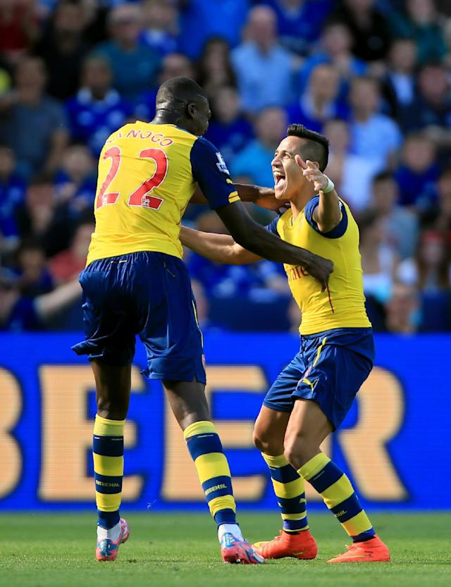 Arsenal's Alexis Sanchez, right, celebrates scoring his side's first goal of the game with teammate Yaya Sanogo during their English Premier League soccer match against Leicester City at the King Power Stadium, Leicester, England, Sunday, Aug. 31, 2014. (AP Photo/Nick Potts, PA Wire)