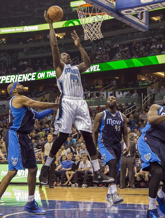 Orlando Magic's Andrew Nicholson (44) lays the ball up as Dallas Mavericks' Vince Carter, left, stands by during the first half of an NBA basketball game in Orlando, Fla., Saturday, Nov. 16, 2013. (AP Photo/Willie J. Allen Jr.)