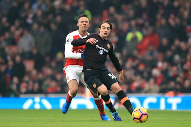 <p>Arsenal's Kieran Gibbs (left) and Hull City's Lazar Markovic (right) battle for the ball </p>