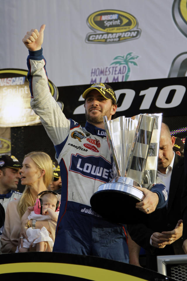 FILE - In this Nov. 21, 2010, file photo, NASCAR driver Jimmie Johnson celebrates after winning his fifth Sprint Cup Series Championship, in Homestead, Fla. Jimmie Johnson is the latest NASCAR superstar to climb out of his car, with the seven-time champion announcing Wednesday, Nov. 20, 2019, that 2020 will be his final season of full-time racing. (AP Photo/Terry Renna, File)