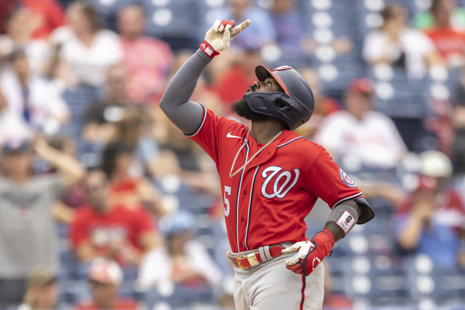 Washington Nationals' Josh Harrison gestures as he approaches home plate after hitting a two-run home run during the second inning of a baseball game against the Philadelphia Phillies, Thursday, July 29, 2021, in Philadelphia in the second game of a doubleheader. (AP Photo/Laurence Kesterson)