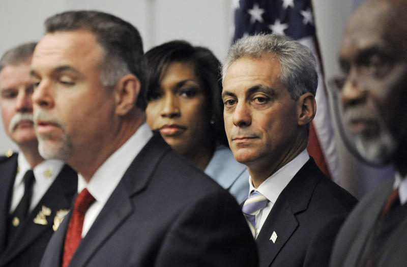 FILE - In this May 2, 2011 file photo, then Chicago Mayor-elect Rahm Emanuel, second from right, looks on while newly-appointed Chicago Police Superintendent Garry McCarthy speaks during a press conference in Chicago. On Wednesday, Feb. 22, 2012, a spokeswoman says Emanuel is against putting Muslims under surveillance as was done in New York and New Jersey by New York police officers. The comments were made after The Associated Press reported that plainclothes NYPD officers took photographs and eavesdropped on conversations inside Muslim businesses in Newark, N.J., while McCarthy headed the Newark force. (AP Photo/Paul Beaty, File)