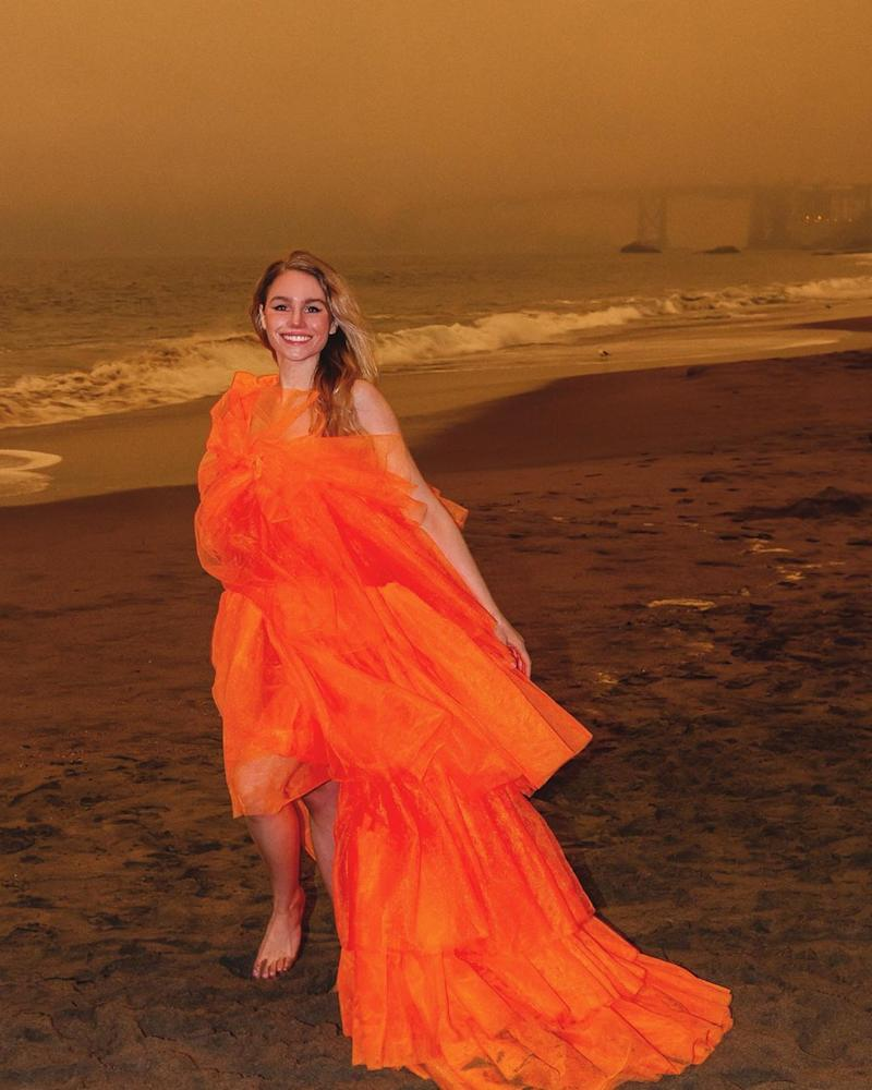 Colette LeClair in an orange dress in San Francisco