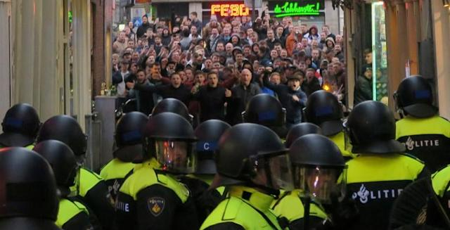 FILE PHOTO: England fans face the Dutch police in Amsterdam ahead of an international friendly against the Netherlands.