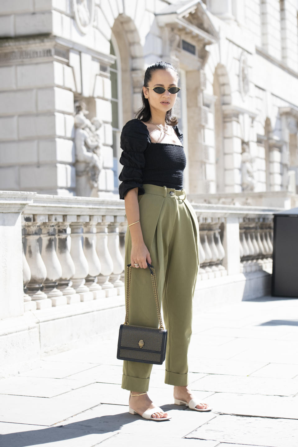 """Anna Rosa Vitiello is seen wearing a Kurt Geiger bag, Reformation top, Maxine shoes and Topshop trousers. <a href=""""https://fave.co/31nzwx1"""" rel=""""nofollow noopener"""" target=""""_blank"""" data-ylk=""""slk:Shop the bag here"""" class=""""link rapid-noclick-resp"""">Shop the bag here</a> [Photo: Getty Images]"""