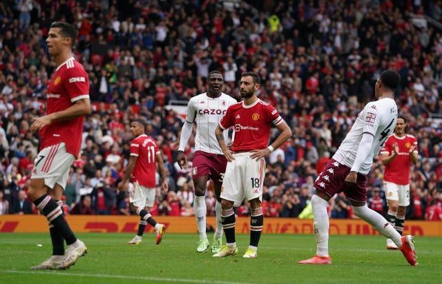 Bruno Fernandes, centre, reacts after missing a late penalty as Cristiano Ronaldo, left, looks on