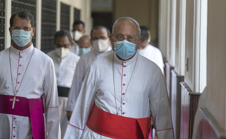 Cardinal Malcolm Ranjith, right, the archbishop of Colombo, arrives to addresses the media in Colombo, Sri Lanka, Tuesday, March 2, 2021. (AP Photo/Eranga Jayawardena)