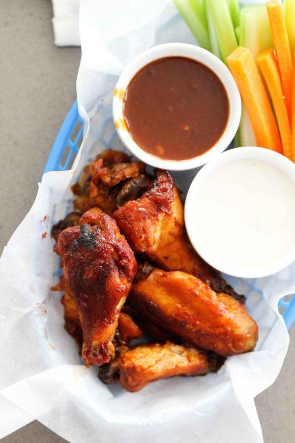 """<p>For a more kid-friendly BBQ wing option, whip these up.</p><p>Get the recipe from <a href=""""https://www.tasteandtellblog.com/slow-cooker-barbecue-chicken-wings/"""" rel=""""nofollow noopener"""" target=""""_blank"""" data-ylk=""""slk:Taste and Tell"""" class=""""link rapid-noclick-resp"""">Taste and Tell</a>.</p>"""
