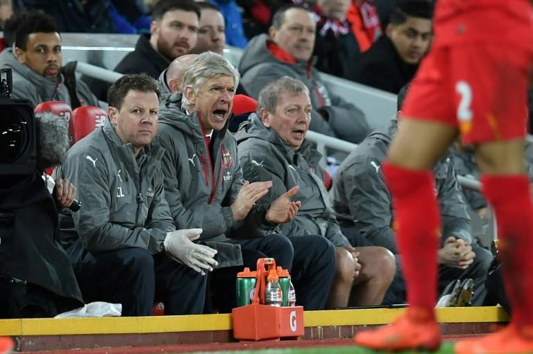 Arsenal's manager Arsene Wenger (C) gestures from the dug-out during their match at Liverpool on March 4, 2017