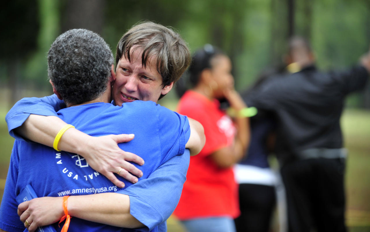 Anti-death penalty supporters hug before hearing the news of a delay of the execution by the U.S. Supreme Court of her brother Georgia death row inmate Troy Davis In Jackson, Ga., Wednesday, Sept. 21, 2011. Davis is scheduled to die Wednesday for killing off-duty Savannah officer Mark MacPhail. (AP Photo/Stephen Morton)