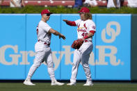 St. Louis Cardinals' Tyler O'Neill, left, and teammate Harrison Bader celebrate a 2-1 victory over the Los Angeles Dodgers in a baseball game Thursday, Sept. 9, 2021, in St. Louis. (AP Photo/Jeff Roberson)