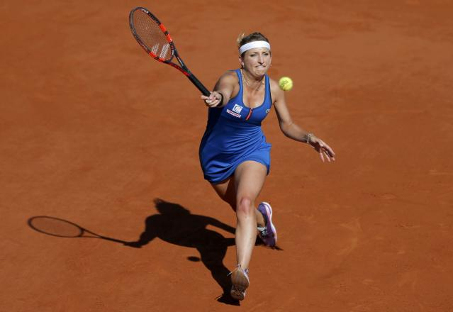Timea Bacsinszky of Switzerland returns the ball to Serena Williams of the U.S. during their women's semi-final match at the French Open tennis tournament at the Roland Garros stadium in Paris, France, June 4, 2015. REUTERS/Vincent Kessler TPX IMAGES OF THE DAY