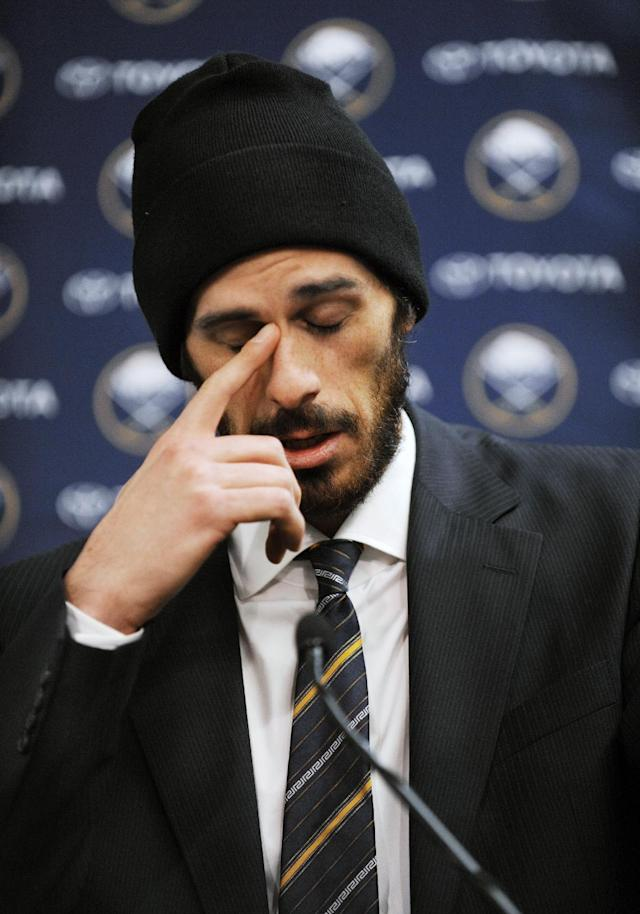 Former Buffalo Sabres goaltender Ryan Miller collects his thoughts during a news conference as he talked about his years with the NHL hockey team, Friday, Feb. 28, 2014, in Buffalo, N.Y. Miller and Steve Ott were traded to the St. Louis Blues Friday night for goalie Jaroslav Halak, forward Chris Stewart, prospect William Carrier, a 2015 first-round pick and a 2016 third-round pick. (AP Photo/Gary Wiepert)