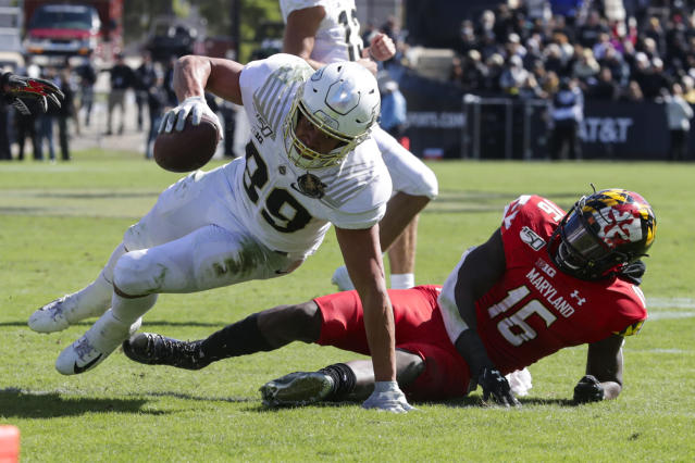 Purdue tight end Brycen Hopkins (89) goes over Maryland linebacker Ayinde Eley (16) during the second half of an NCAA college football game in West Lafayette, Ind., Saturday, Oct. 12, 2019. Purdue defeated Maryland 40-14. (AP Photo/Michael Conroy)