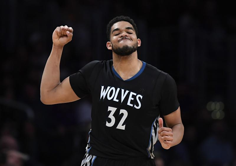 Karl-Anthony Towns pumps his fist in exultation at the thought of sweet, sweet Fitbit jersey-ad money coming into his organization. (AP)